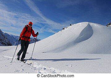Young woman doing ski touring Outdoor winter activity
