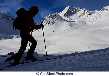 Silhouette of mountaineer. Outdoor winter activity