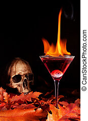 Halloween cocktail - Burning halloween cocktail with skull...
