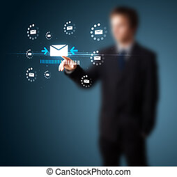 Businessman pressing virtual messaging type of icons -...