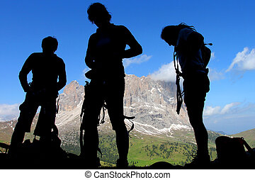 Climbers silhouettes in the Dolomites, Italy