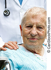 Senior lady and doctor - Senior lady in wheelchair and...