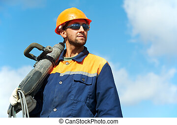 portrait of construction worker with perforator - Portarait...