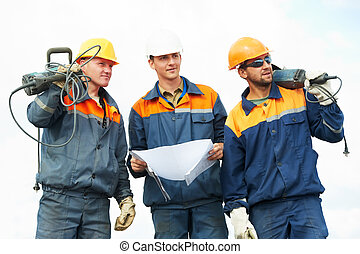 construction workers with power tools - positive Builder...