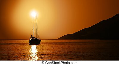 sailboat - A silhouette of a sailboat in the sunset