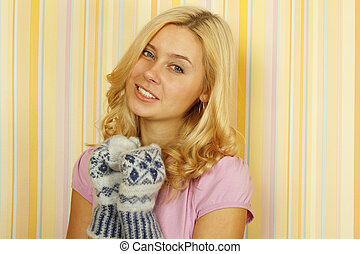 Beautiful young woman in mild winter mittens