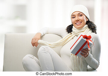 Christmas presents - a beauty young girl with christmas gift