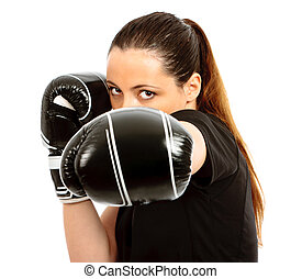 Boxing Clever - A young female wearing black boxing gloves...
