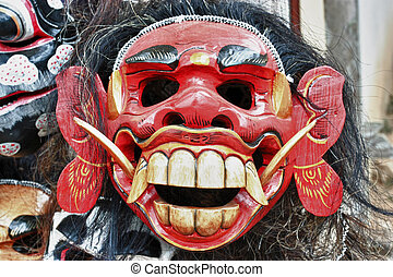 balinese mask in a shop - balinese red evil mask in a shop