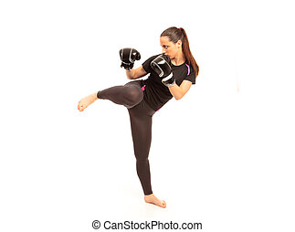 Karate Kicking - A young female performing a martial arts...