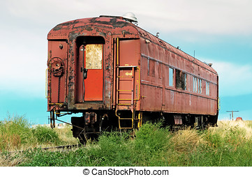 Old passenger railcar - Rusted and worn out, an old...