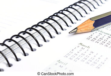 Spiral bound note book with pencil