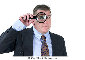 Man with magnifying glass - A man inspects things with his...