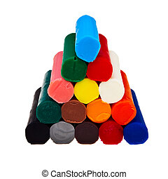 Colorful soft plasticine bars in pyramid isolated over white background.