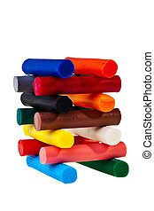 Stacked colorful plasticine bars over white background.