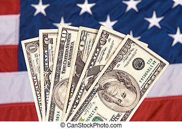 American currency and flag - American currency against an...