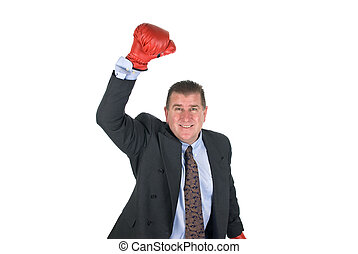 Businessman raising arm in victory
