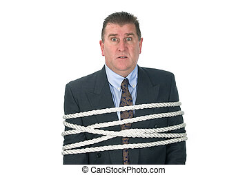 Businessman tied up - A businessman is tied up by his...