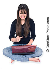 Frustrated woman and laptop - A young woman gets frustrated...