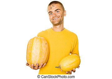 Young man holding a yellow squash