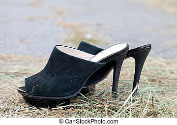 Black women shoes from shammy leather on withered straw...