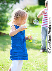 Blowing soap bubbles