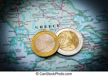 Euro coins on a map of Greece Greek financial crisis