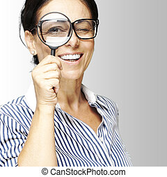 woman with magnifying glass - portrait of woman with looking...