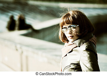 Young woman on a city street - Thoughtful young woman on the...