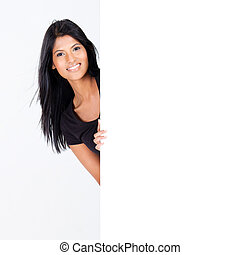 woman behind blank white board - attractive hispanic woman...