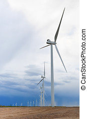 Wind turbines making electricity - Row of wind turbines...