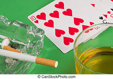 Gambling still life - Deck of cards, smoke and whiskey,...
