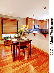Dining room table and kitchen - Warm cherry floor and dining...