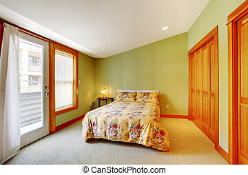 Green bedroom with golden wood