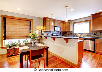 Dining room and kitchen with golden colors