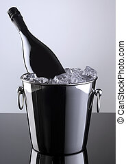 Sparkling bottle in a bucket with ice