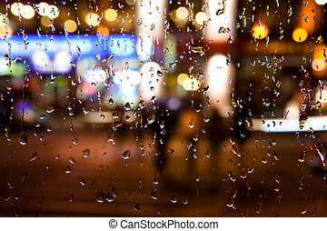 autumn night city background - Wet the window with the...