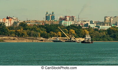 port crane at work - working port crane at the river Ob...