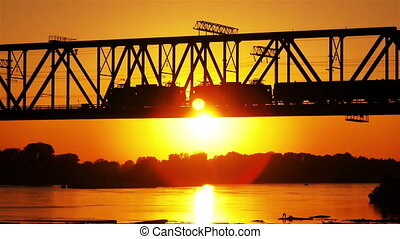 railway bridge at sunset - a train crossing a railway bridge...