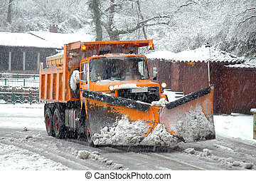Snow Plow - Orange snow plow in action