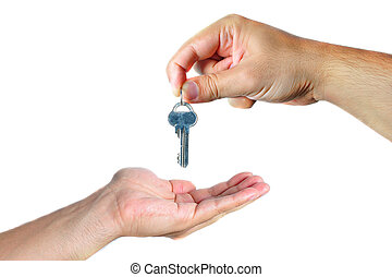 Handing over the keys - A male's hand giving a key to...