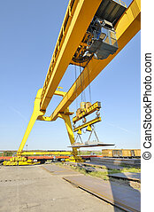 crane and steel plates