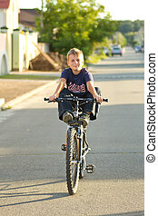 boy on a bicycle - boy riding a bicycle on his way to the...