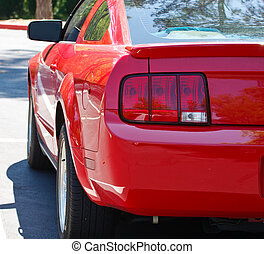 Tail Lights of Red Sports Car - The tail lights of a red...