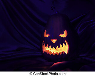 Halloween - pumpkin in the dark with glowing from the inside...