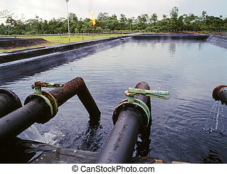 Discharge pond at a petroleum production station in the...