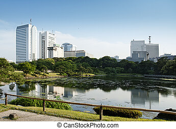 city park and skyline in tokyo japan