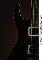 Black Electric Guitar on Red
