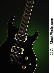 Black Electric Guitar on Green