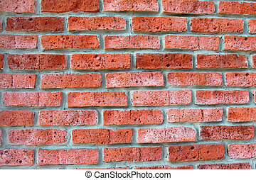 Texture laying walls of red brick of porous. Abstract